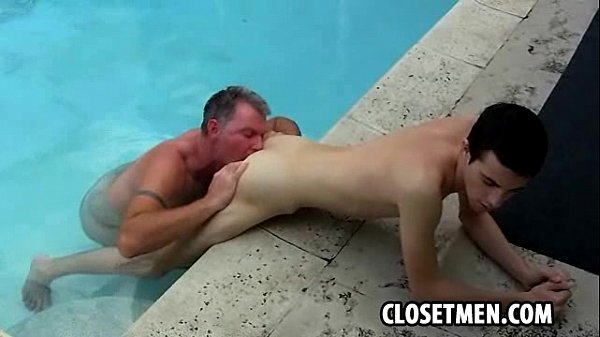 An old gray haired stud is fucking a twink